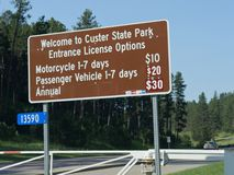 Signs at Custer State Park, South Dakota. Custer County, South Dakota--July 2018: Big billboard showing the respective admission fees to Custer State Park in stock photo