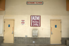 Signs directing people to ATM machine and restrooms, north of Tucson, AZ Royalty Free Stock Photography