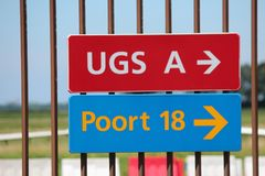 Signs on a fence at Rotterdam The Hague Airport stock photography