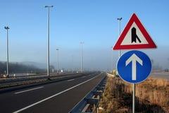 Signs in foggy motorway. In Croatia Stock Image