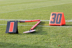 Signs of football. Sticks and signal thirty yards in football Stock Images
