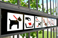 Signs at the gate of public park Royalty Free Stock Photography