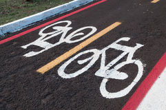 Signs on the ground for cyclists. bike lane track. Right to come and go cycling only. Royalty Free Stock Photo