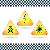 Signs-high voltage, poison; laser  radiation. Stock Images