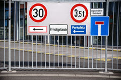 Signs on the iron gate. Many different traffic signs at the iron gate of an industrial site Royalty Free Stock Images