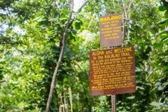Signs before Kalalau trail. On the island Kauai, Hawaii Royalty Free Stock Photo