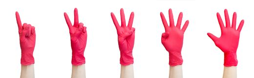 Healthy, vitamins, vaccination, medical store, pharmacy, recovery, proper nutrition concept - Signs made of red medical gloves. Fi. Signs made of red medical stock photos