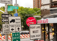 Signs. Many signs at a street corner in New York City Stock Photos