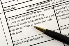 Signs the medical claim form Stock Images