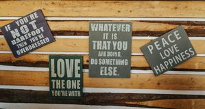 Signs with motivation words on rustic wood. Vintage Royalty Free Stock Images