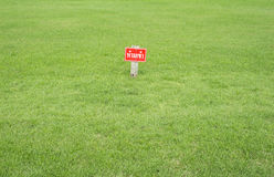 Signs no entry in Thai language on green grass Stock Photo