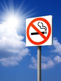 Signs No smoking. On the sky and the sun background royalty free stock photo