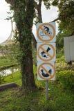 Signs no smoking and no fishing Stock Photos