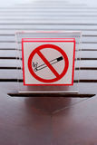 Signs of no smoking on the table. Stock Image