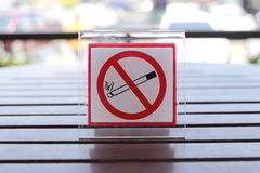 Signs of no smoking on the table. Royalty Free Stock Image