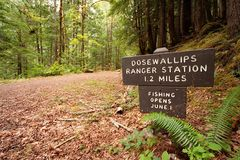 Signs in the Olympics. A sign at the Dosewallups entrance to the Olympic National Park in Washington stock photos