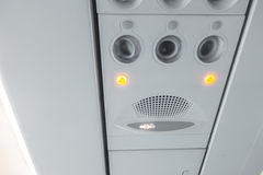 Signs panel above the seat on plane . Royalty Free Stock Image