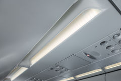 Signs panel above the seat on plane . Stock Image