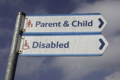 Signs for parent and child and disabled parking in a Tesco car p. Ark Warrington May 2018 Royalty Free Stock Image
