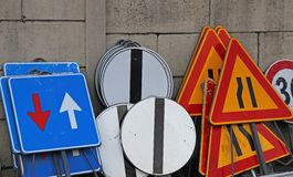 Signs piled up in stock ready to be used in road construction Stock Photo