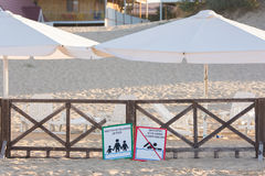 Signs a - place children bathing, storm, swimming prohibited - lie on the sandy beach near the Royalty Free Stock Image