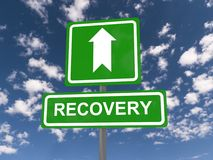 Signs pointing to recovery. Roadside signs saying 'recovery' with large bold white arrow pointing upwards and a blue cloudy sky background stock photo