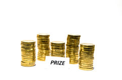Prize sign at coin piles Stock Images