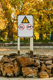 Signs prohibiting bathing and dog walking. Warning notice : swimming and walking dogs banned. a fountain and a swimming pool without water outdoor autumn Royalty Free Stock Images