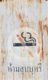 Signs prohibiting smoking cigarettes,. Signs prohibiting smoking that was left abandoned until the Rusty Royalty Free Stock Photography
