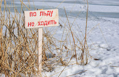 Signs prohibiting walking on ice. At river royalty free stock images