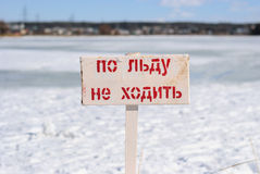 Signs prohibiting walking on ice. At river royalty free stock photo