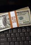 Signs of Prosperity, Laptop Computer and Cash Royalty Free Stock Photography