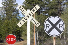 Signs at a Railroad Crossing Stock Photos