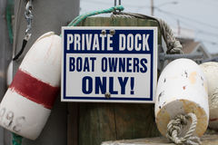 Signs that Reads `Private Dock, Boat Owners Only!` Stock Photo
