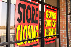 Signs of the Recession. Another store displays Going out of Business signs on their windows royalty free stock photo