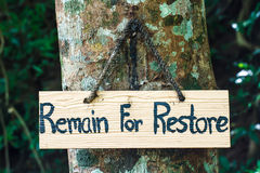 Signs remain for restore on tree Stock Image