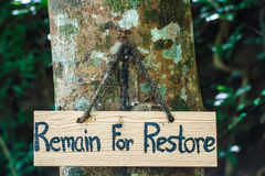 Signs remain for restore on tree. In garden Stock Images