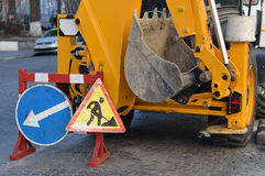 Signs repair road and excavator. In worked Stock Image