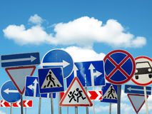 Signs of the road on sky background. Several caution signs of the road on sky background Stock Photo