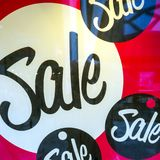Signs of sale in shop windows of store. Big letters indicate sale in shop windows of store Stock Photography