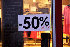 Signs of sale on a show window Stock Photo