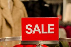 Signs of sale in the store.  royalty free stock photo