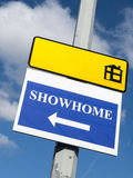Signs. Showhome sign with direction arrow on streetlight Stock Images