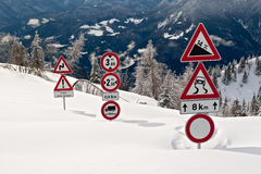 Signs in Snow. Traffic signs covered by snow Stock Photo