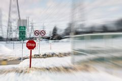 Signs on a snowmobile trail in Laval. Snowmobile signs with artistic blur in the background on a winter day in Laval, Quebec, Canada Royalty Free Stock Photography