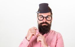 Signs someone is smarter than you. Guaranteed ways appear smarter. Tricks to seem smarter than you are. Man bearded. Hipster hold cardboard top hat and royalty free stock images