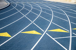 Signs on stadium tracks. Tracks at the track-and-field stadium Royalty Free Stock Images