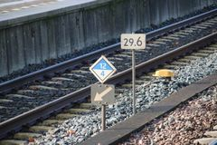 Signs for stop position and milage between tracks at the station of Dordrecht, the Netherlands.  Stock Photos