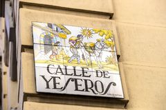 Signs of street names are created from ceramic tiles with a picture illustrating the name of the street. MADRID, SPAIN - 27 MARCH, 2018: Signs of street names Stock Image