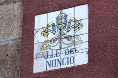 Signs of street names are created from ceramic tiles with a picture illustrating the name of the street. MADRID, SPAIN - 27 MARCH, 2018: Signs of street names Royalty Free Stock Photo